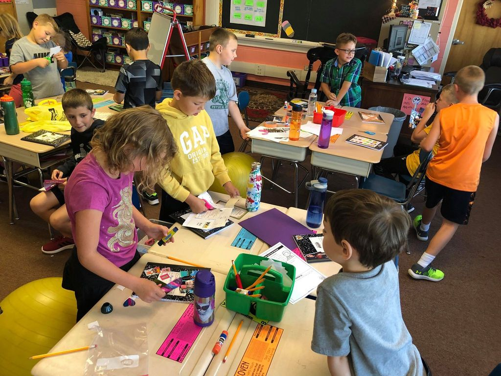 Mrs. Asquith's third graders decorating their writer's journals!